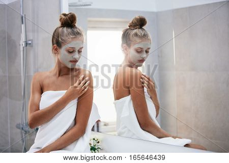 Woman Doing Skin Treatment After Bath