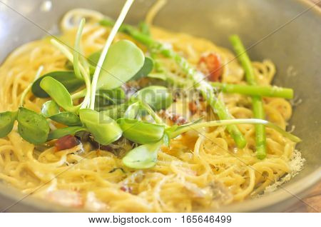 Pasta Carbonara Spaghetti with bacon parsel and parmesan cheese dish