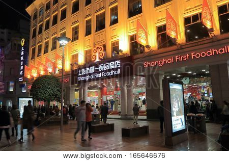 SHANGHAI CHINA - OCTOBER 30, 2016: Unidentified people visit Bao Shanghai First Foodhall on Nanjing Road. Shanghai First Foodhall is one of the biggest food mall in Shanghai.