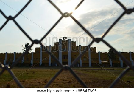 Cuartel Moncada entry behind the fence in Santiago de cuba