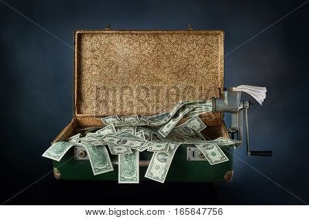 Ancient old green suitcase full of banknotes on a blue background