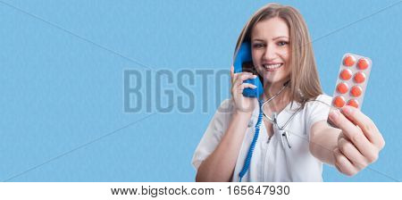 Pretty Young Medic Talking On Telephone
