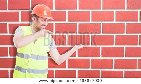 Happy Constructor Pointing At His Empty Palm