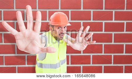 Scared Constructor Doing A Rejection Gesture