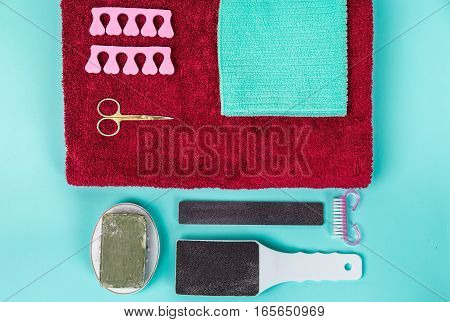 Top view of manicure and pedicure equipment on blue background. Still life.