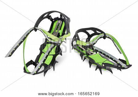 Crampons steel with green plastic anti-balling. Isolated on white background