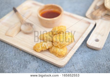 Tasty chicken nuggets homemade food on wood tray