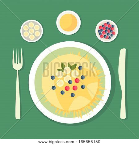 The flat composition. Pancake with honey dish decorated with berries bananas and leaves. Dish with cutlery.