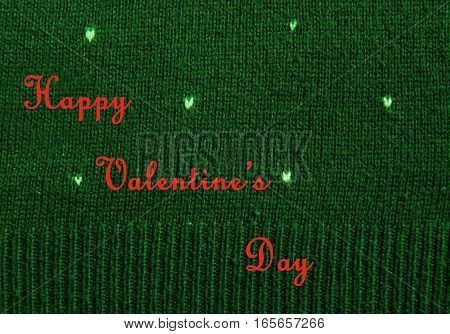 white hearts on knitted green wool background, greeting card