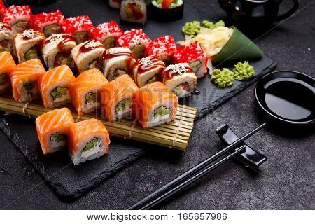 Japanese Cuisine. Sushi Roll With Fresh Ingredients On A Stone Plate And Background.