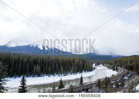 Grand View of Bow River and Mountain Range in Winter Canadian Rockies Alberta Canada