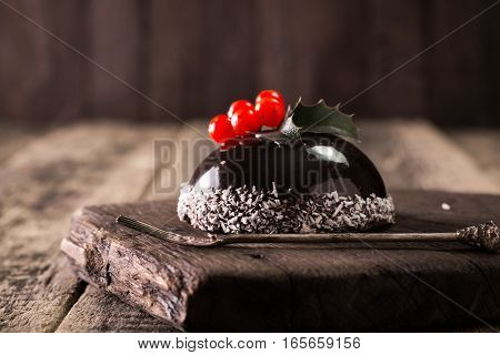 French Mousse Cake Covered With Chocolate Mirror Glaze. Modern European Cake Pastry With Christmas D