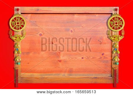 Chinese good luck symbols on wooden frame background Chinese new years concept.