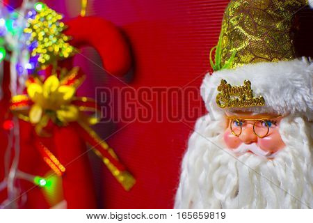 Santa claus doll on red background. Christmas Eve.