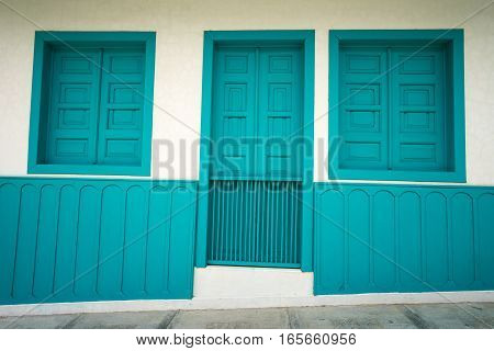 brightly coloured door and windows in Colombia