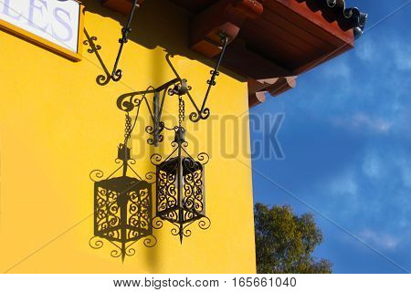 beautiful vintage lamp on the background of yellow wall
