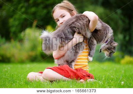 Cute Little Girl Holding Giant Pet Cat