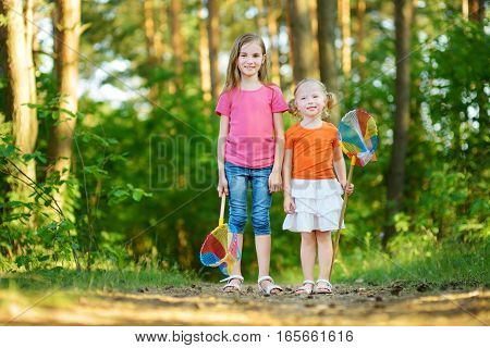 Two Funny Little Sisters Having Fun During Forest Hike