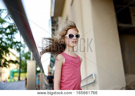 Adorable Little Girl Wearing Sunglasses Taking A Walk