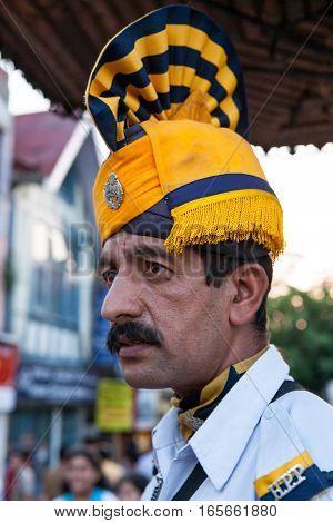 SHIMLA, INDIA. June 8, 2009: Police in striped turban at the intersection of ridge road. Shimla, Himachal Pradesh, India