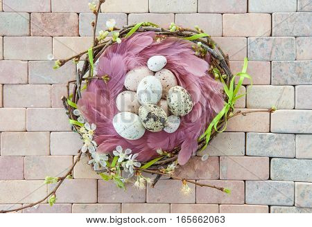 Colorful easter decorations on a marbled stone background