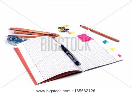 Top view of school workspace with notebook pen and stickers. Isolated on white background. Back to school.