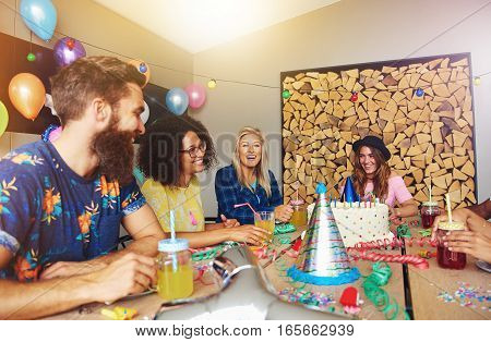 Four Friends Having Fun At A Birthday Party