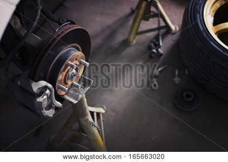 Car brake disc without wheels closeup with repair.