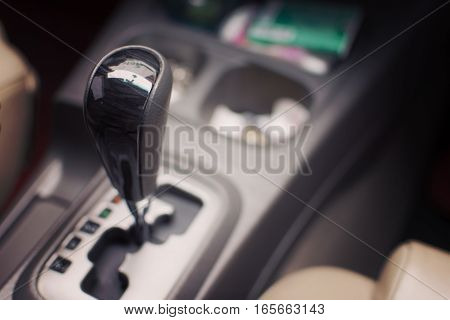Gear stick on auto transmission car. selective focus.