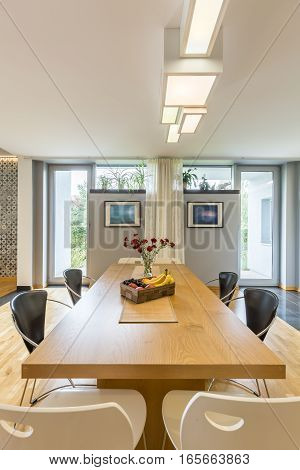 Wooden Dining Table In Grey Room