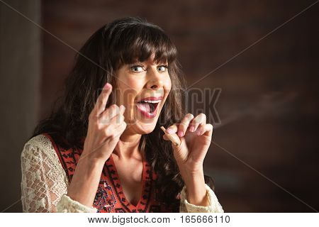 Laughing Woman Pointing Finger While Smoking Pot
