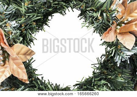 Synthetics christmas wreath closeup isolated over white as a frame