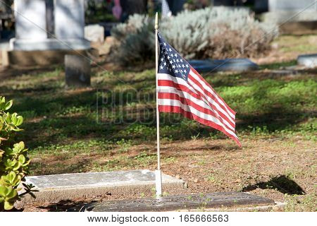American Flag placed at the grave of soldier in memory and honor of service to our country