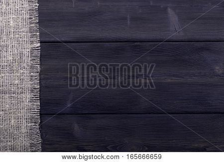 burlap texture on dark  wooden background texture