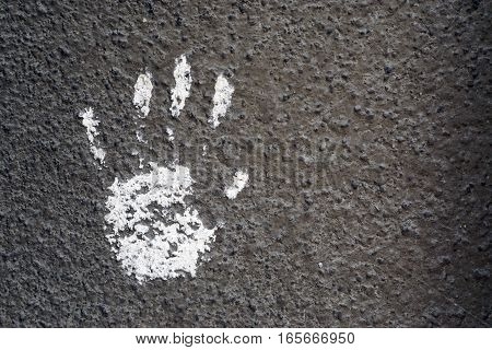 White Hand Imprint On Grey Textured Wall 1
