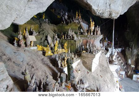 The Pak Ou Caves of Laos contain thousands of Buddha statues left behind by worshippers over time