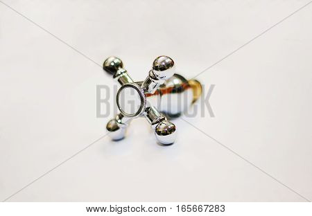 The water tap faucet for the bathroom and kitchen mixer isolated on a white background. Chrome-plated metal.