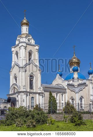 Russia Rostov- on-Don. Orthodox Church of Our Lady of Kazan . Solar patches of light on the gilded domes against the bright blue sky .