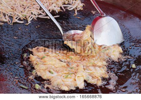 Making crispy shellfish fried on pan delicious