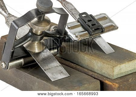 Chisels Clamped In Angle Guide Jigs  On Grinding Whetstones