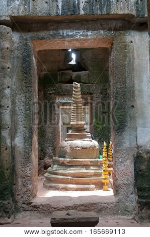 Buddhist relic tower in the middle of an ancient temple ruin in Cambodia