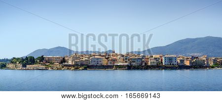 Panoramic skyline view from water of small mediterranean town on Corfu island Greece