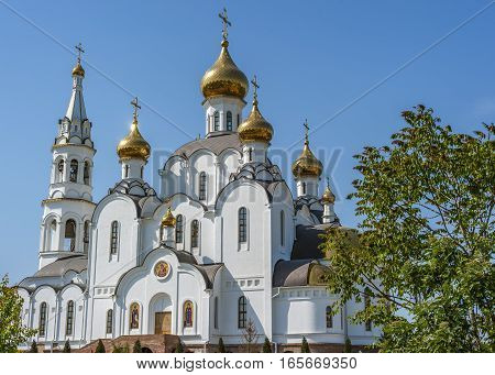 Pyatiprestolny Trinity Church in Iver convent in Rostov - on - Don . The evening sun gilded walls of the temple . Happy Easter eve .