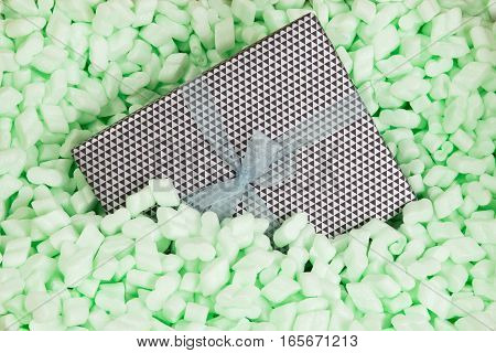 Gift wrapped present in polystyrene loosefill packaging
