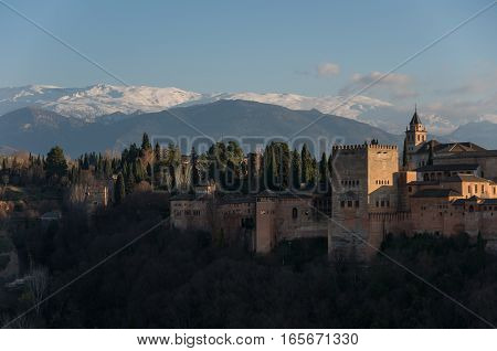 View Of Alhambra Palace In Granada, Spain With Sierra Nevada Mountains In Snow At The Background . G