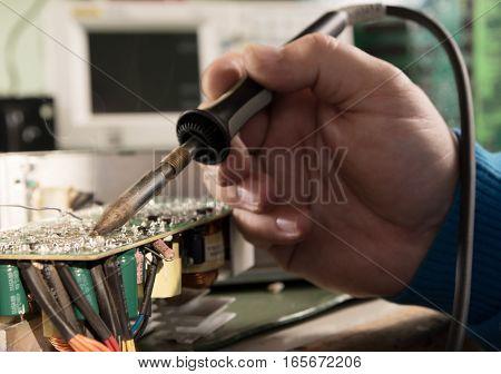 Technician repair circuit board in electronic laboratory
