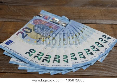 Amount of euro banknotes on an old wood