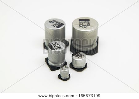 Different size SMD electrolytic capacitors. Capacitance and voltage marked on the top of the capacitor.
