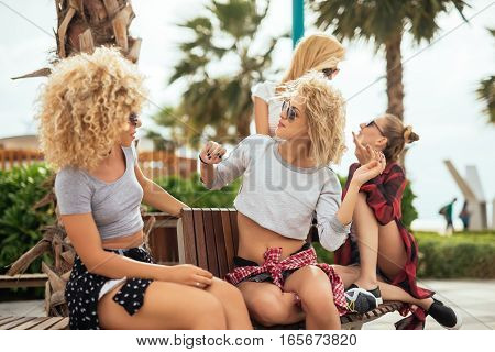 Four happy friends having fun outdoors on the beach.