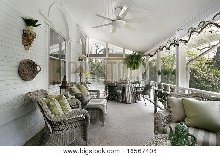 Screened-in porch with wicker furniture